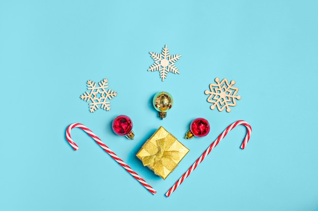Happy new year, flat lay composition, place for text christmas decor on blue color backgro Premium Photo