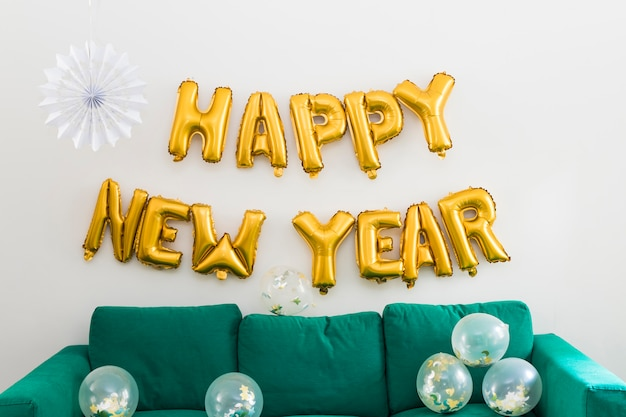 Happy new year inscription from yellow balloons Free Photo