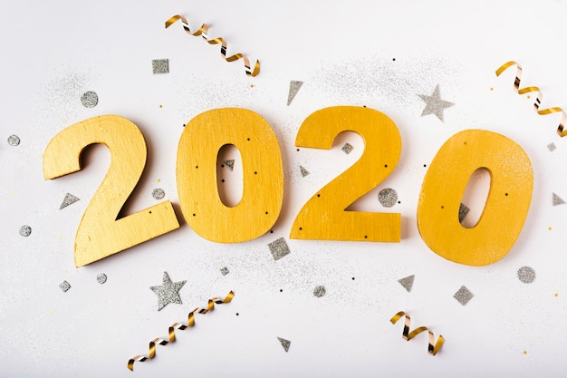 Happy new year with numbers 2020 and ribbons Free Photo