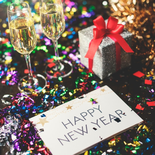 Happy new year word on card holiday celebration Free Photo
