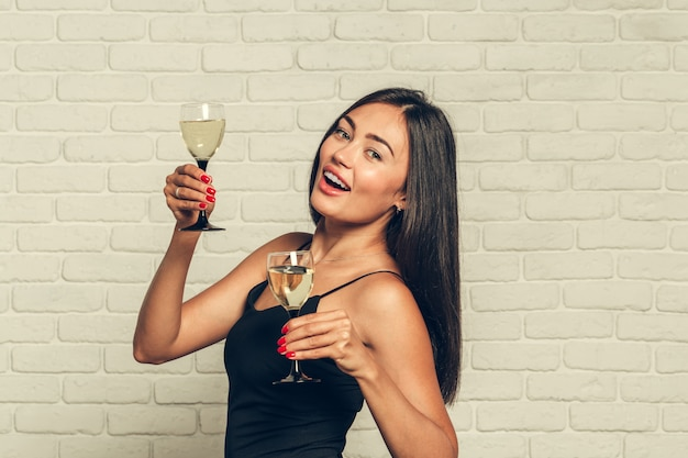 Happy new year to you, one young and beautiful woman dancing with glass of champagne Premium Photo