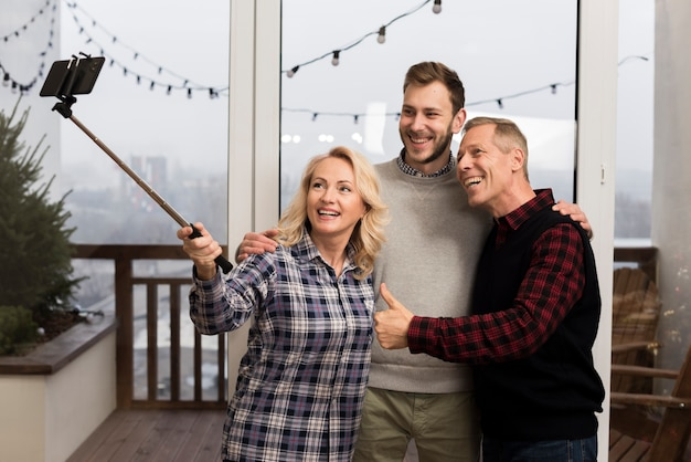 Happy parents taking a selfie with son Free Photo