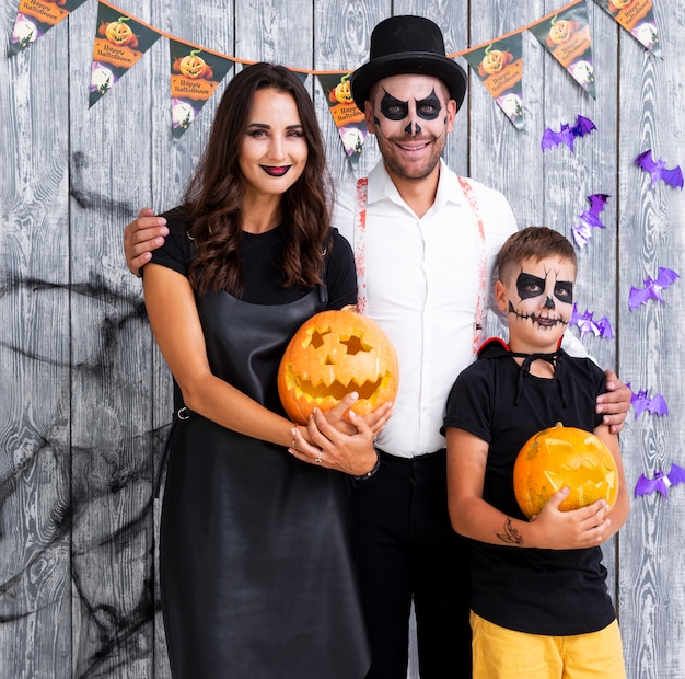 Happy parents with son posing for halloween Free Photo