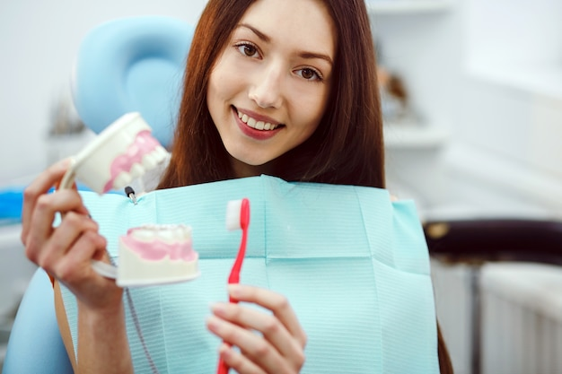 Happy patient with a toothbrush and dental mold Photo | Free Download
