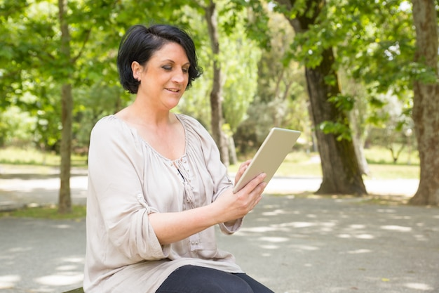 Happy peaceful woman consulting internet Free Photo