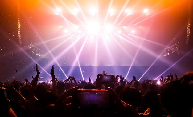 Happy people dance in nightclub party concert Premium Photo
