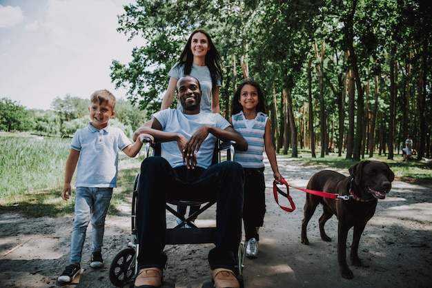 Happy people outdoor disabled man family and dog Premium Photo