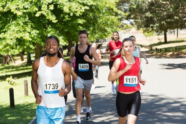 Happy people running race in park Premium Photo