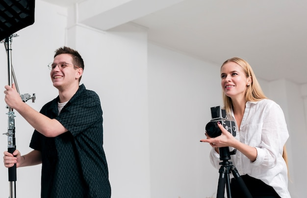 Happy people working in a photography studio Free Photo