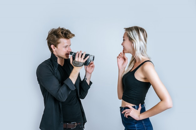 Happy portrait of couple holding video camera and record clip video Free Photo
