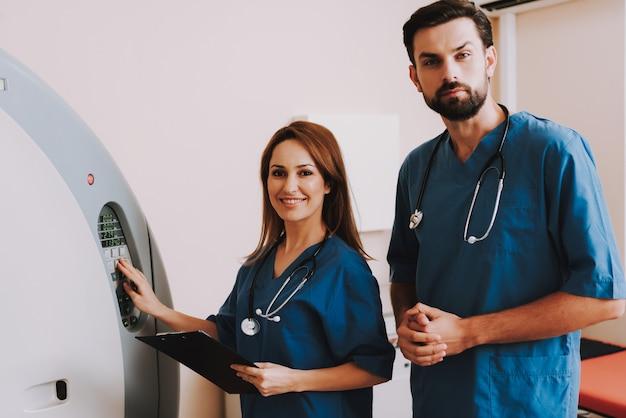 Happy radiologists are setting mri machine mode Premium Photo