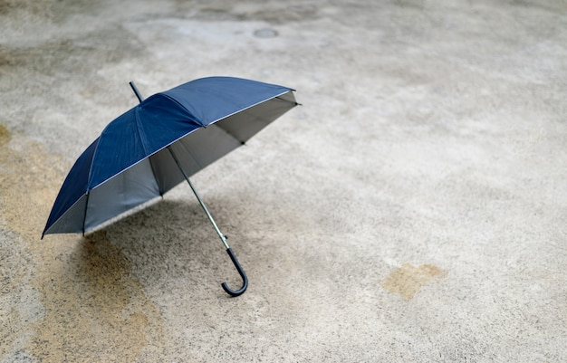 Happy rainy day concept. black umbrella on road, top view Premium Photo
