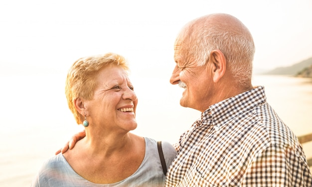 Happy retired couple having fun at tropical travel destination Premium Photo