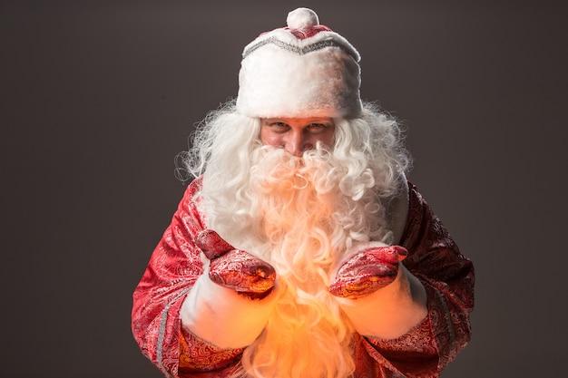 Happy santa claus looking at camera Free Photo