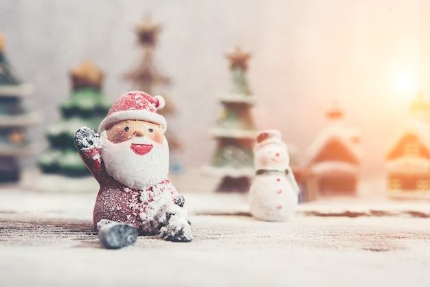 Happy santa claus with snowman background Free Photo