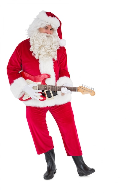 Happy santa playing electric guitar Premium Photo