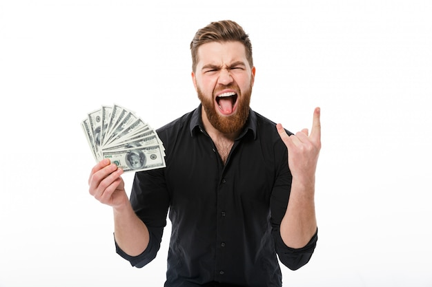 Happy screaming bearded business man in shirt holding money Free Photo