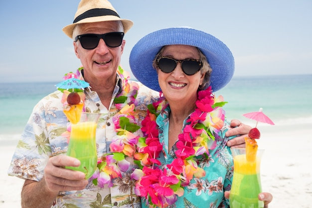 Happy senior couple with a cocktail drink Premium Photo