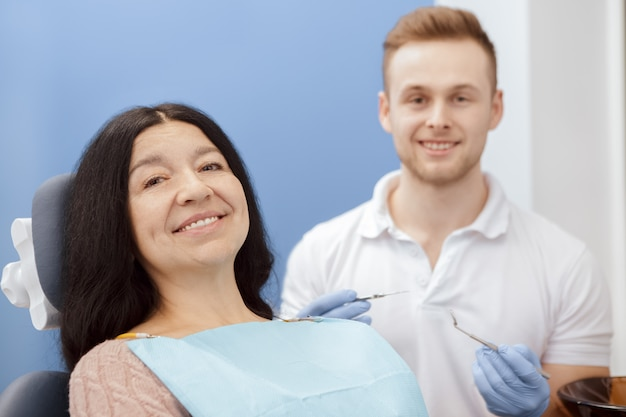 Happy senior female patient at the dentist appointment Premium Photo