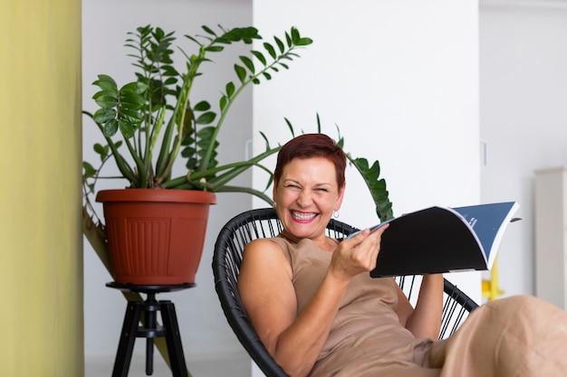 Happy senior lady laughing at camera Free Photo