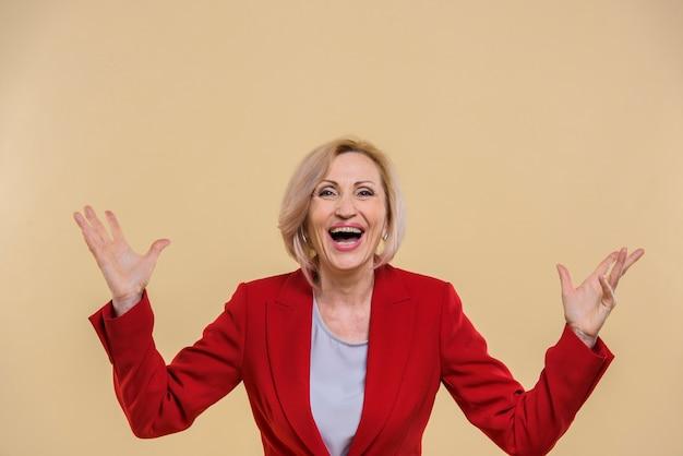 Happy senior woman screaming Free Photo
