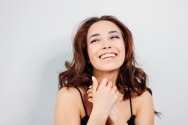 Happy sensual smiling girl asian young woman with dark long curly hair Premium Photo