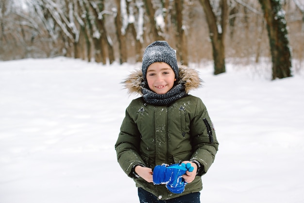 Happy smiling boy in winter clothes during walk Premium Photo