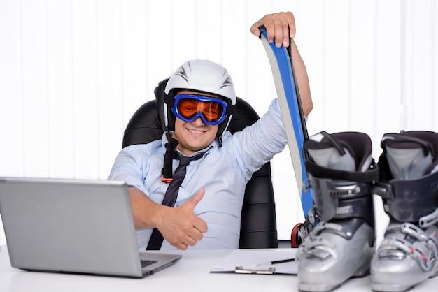 Happy smiling business man in ski hamlet and mask. Premium Photo