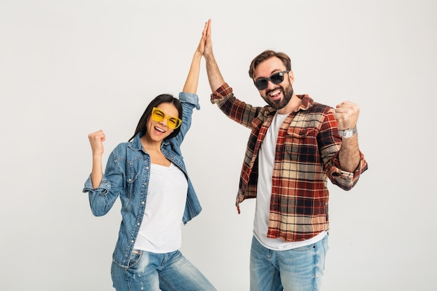 Happy smiling couple giving five winners team isolated on white studio Free Photo