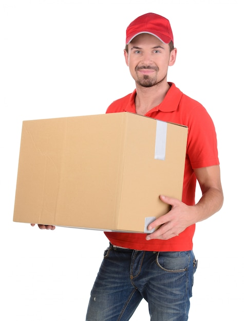 Happy smiling delivery man carrying boxes. Premium Photo