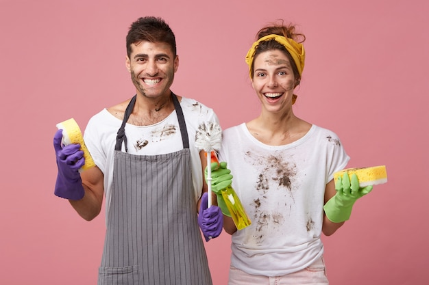 Happy smiling male and female wearing casual clothes being happy to finish spring cleaning Free Photo