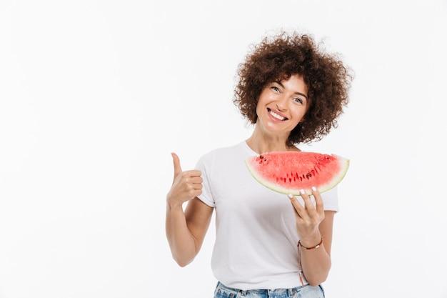 スイカのスライスを保持している幸せな笑顔の女性 無料写真