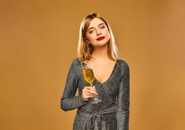 Happy smiling woman in stylish glamorous dress with champagne glass. Free Photo