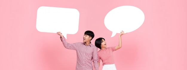 Happy smiling young asian couple with speech bubbles Premium Photo