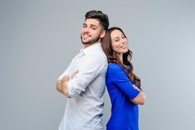 Happy and smiling young couple of man and woman isolated Premium Photo