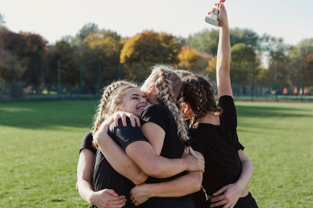 Happy sportive women embracing each other Free Photo