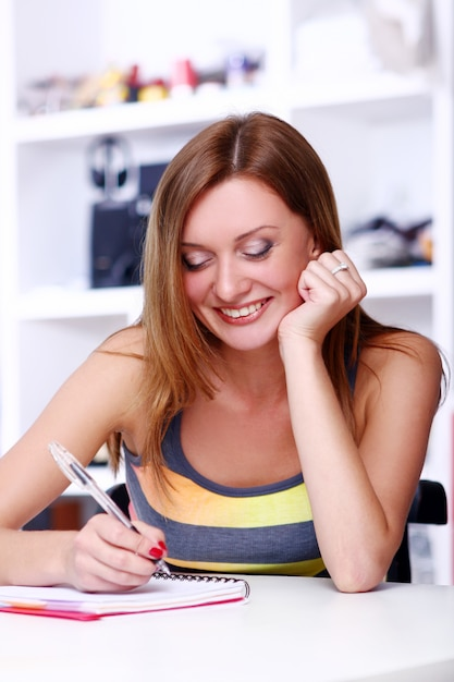 Happy student girl writing somethink Free Photo