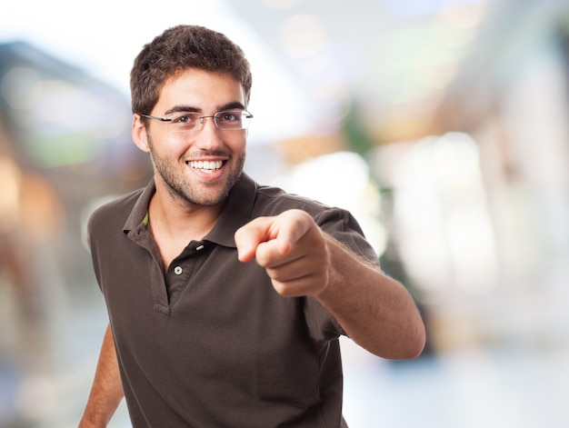 Happy student showing the index finger Free Photo