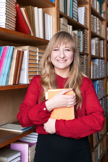 Happy student woman holding a book Premium Photo