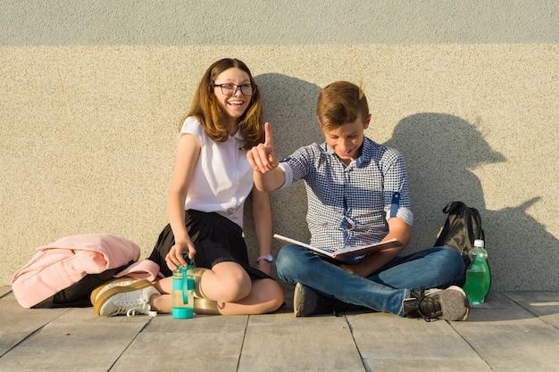 Happy students on campus pathway Premium Photo