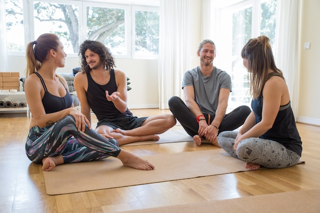 Happy students chatting after yoga class Free Photo