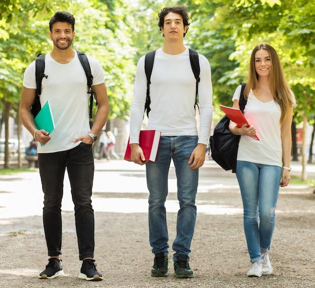 Happy students outdoor smiling full length Premium Photo