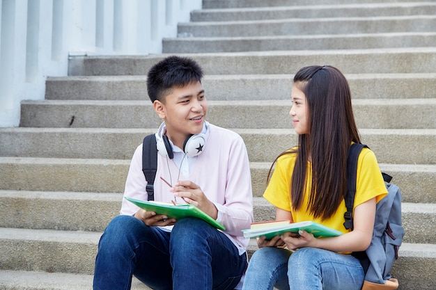 Happy students outdoor with books Premium Photo