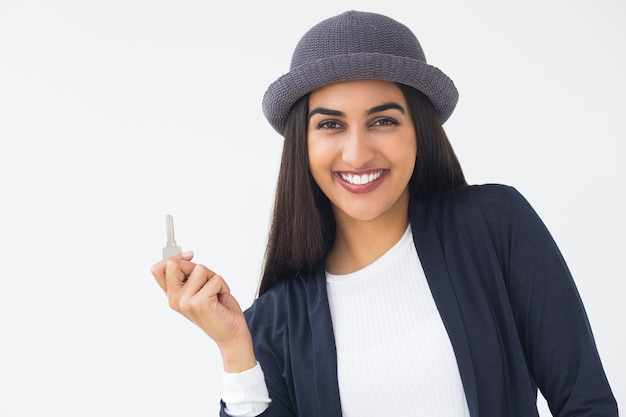 Happy stylish young indian woman showing key Free Photo