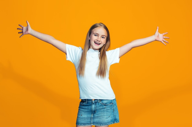 Happy success teen girl celebrating being a winner. dynamic energetic image of female model Free Photo