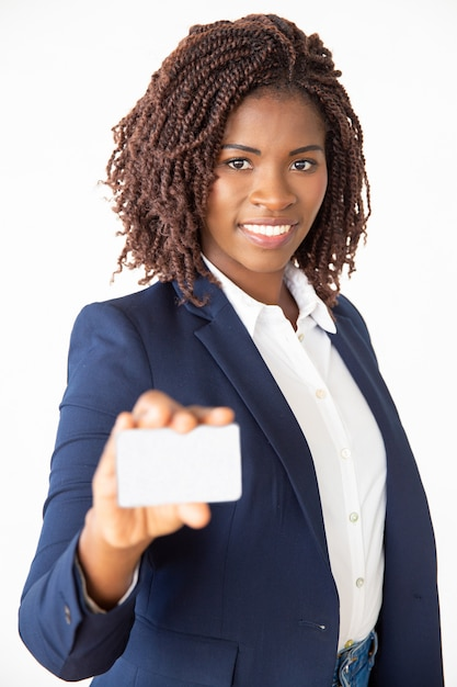 Happy successful bank manager advertising credit card Free Photo