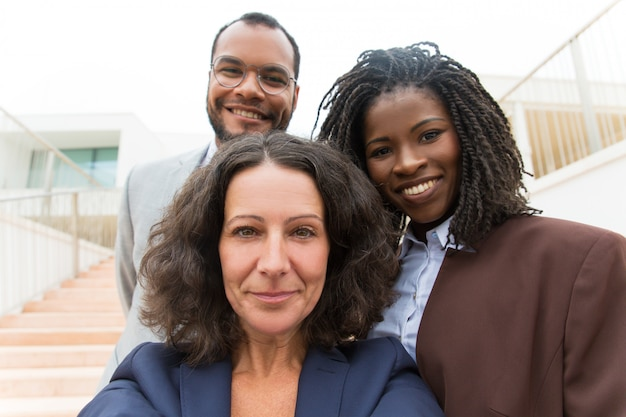 Happy successful business team taking selfie outside Free Photo