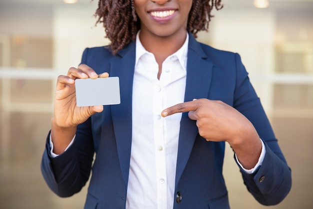 Happy successful businesswoman showing id card Free Photo