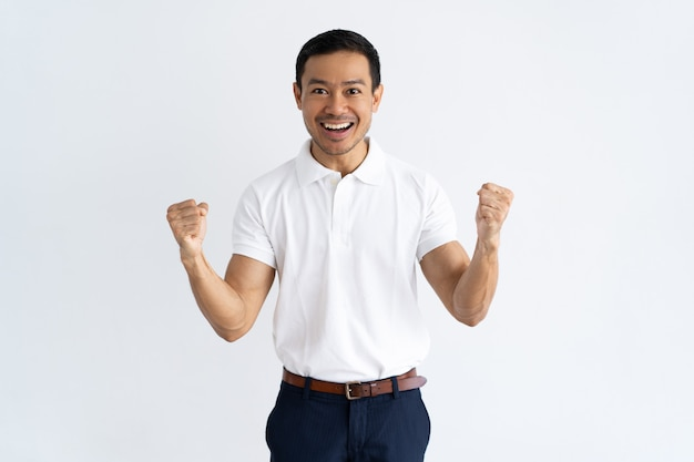 Happy successful guy achieving goal Free Photo