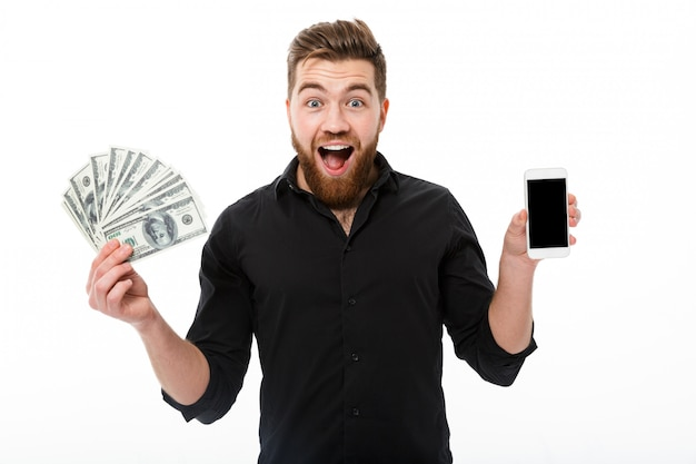 Happy surprised bearded business man in shirt holding money Free Photo